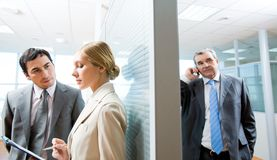 Planning work. Portrait of serious business partners interacting in office Royalty Free Stock Image