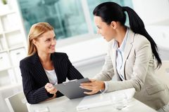 Planning work. Portrait of two young women at workplace planning work together Stock Photo