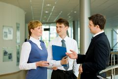 Planning work. Photo of confident businessteam planning work or consulting each other Royalty Free Stock Image
