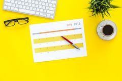 Planning at work. Strategy planning. Business development concept. Set the goals. Calendar on yellow office desk top. View royalty free stock photo