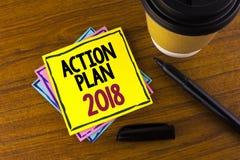 Plano de ação 2018 do texto da escrita da palavra O conceito do negócio para planos visa o desenvolvimento da melhoria dos objeti Foto de Stock Royalty Free