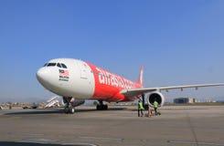 Plano de Air Asia Imagem de Stock