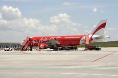 Plano de Air Asia Imagens de Stock