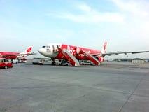 Plano de Air Asia em LCCT Imagem de Stock Royalty Free