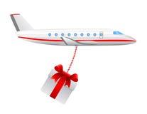 Plano de ar da carga com presente Imagens de Stock Royalty Free