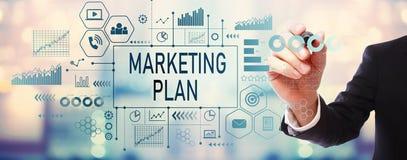 Plano de marketing com homem de negócios foto de stock