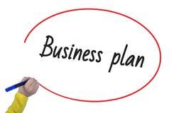 Plano de negócios da escrita da mão da mulher com marcador Imagem de Stock Royalty Free