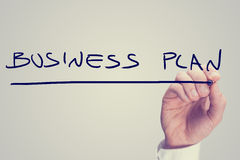 Plano de negócios da escrita da mão em uma tela virtual Fotografia de Stock