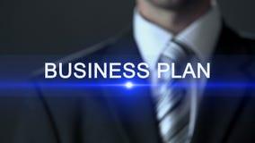 Plano de negócios, homem na ação do desenvolvimento de negócios da tela tocante de terno de negócio video estoque