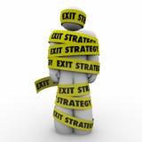 Plano do escape de Person Wrapped Caught Yellow Tape do homem da estratégia de saída Foto de Stock