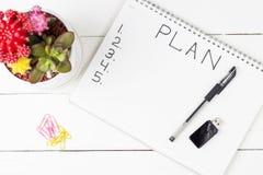 Plano no bloco de notas, close-up da inscrição, vista superior, conceito do planeamento, ajuste do objetivo foto de stock royalty free