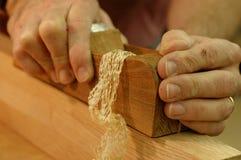 Plano y el afeitar del carpintero Imagenes de archivo