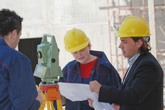 Plans. Construction workers read building plan Stock Photos