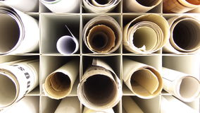 Plans. Several rolled plans lying in boxes Royalty Free Stock Photos