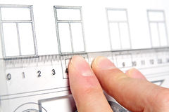 Plans. The detailed look at fingers with plans Royalty Free Stock Images