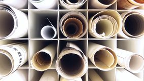 Plans. Several rolled plans lying in boxes Royalty Free Stock Images