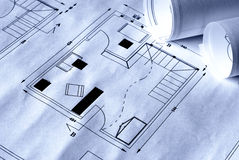 Plans. Architectural plans used for construction background - in blue light Stock Photos