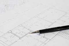Plans et crayon noir Images stock