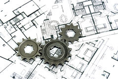 Plans with gears. Some gears over plans document Stock Photos