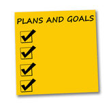 Plans and goals. Yellow paper with copyspace provided for plans and goals Royalty Free Stock Photography