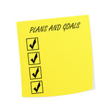 Plans and Goals on Post-it Note. Yellow post it or sticky note with plans and goals checklist Royalty Free Stock Photography