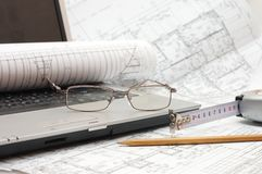 Plans and laptop. Construction idea Royalty Free Stock Photo