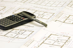 Plans and office set. Office set - plans, calculator and pen on the table Royalty Free Stock Image