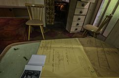 Plans on a table in old house royalty free stock photos
