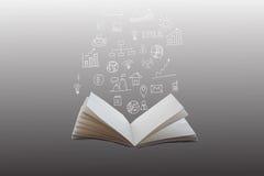 Plans tirés par la main et diagrammes financiers sortant d'un livre ouvert images libres de droits