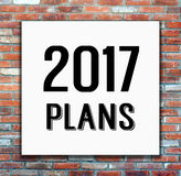 2017 plans on white poster on brick wall background. 2017 plans on white poster on brick wall, business background Stock Photos