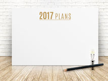 2017 plans year text on white paper poster with black pencil and Royalty Free Stock Images