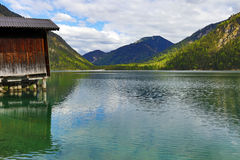 The Plansee with fisherman`s hut in Austria Stock Image