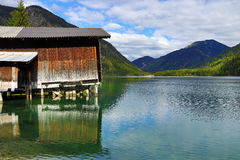 The Plansee with fisherman`s hut in Austria Royalty Free Stock Photos
