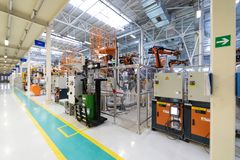 Car manufacturing plant. Automotive shop. The Assembly line for manufacturing cars. The plant of the automotive industry. Shop for the production and Assembly stock photography