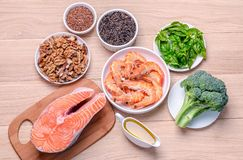Plant-based and animal sources of Omega-3 acids. On the wooden surface Stock Images