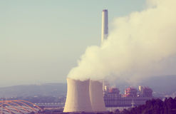 Plant with chimney and cooling towers Royalty Free Stock Photography