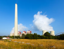 Plant with chimney and cooling towers Stock Photo