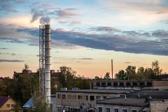 Pipe factory smoke in the background of a beautiful sky royalty free stock image