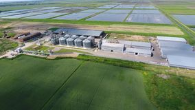 Plant for the drying and storage of grain. Rice plant in the middle of fields stock video