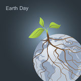 Plant on Earth and its roots around planet. Earth Day and Go green concept Royalty Free Stock Images