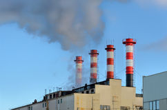 Plant emissions. Four striped industrial chimneys. Plant emissions stock photography
