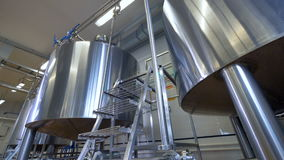 Plant equipment. Modern stainless steel tanks at factory floor. 4K. stock video