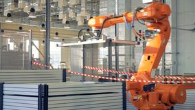 Modern Industrial Robot arm working in factory.