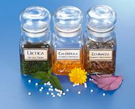 Plant extract in bottles and homeopathic granules Royalty Free Stock Photography