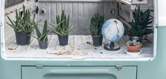 Plant in flower pot on truck with global model. Vintage style royalty free stock image