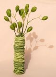 Plant in green vase Royalty Free Stock Image