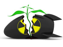 Plant growing through atomic bomb Stock Image