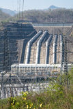 Plant Load power of the river from the dam to the larger vertica Royalty Free Stock Photo