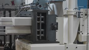 Plant machinery for paper products manufacturing. Punching or cutting machine. Process. Production of disposable utensils from environmentally friendly stock video footage