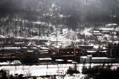 Plant of methanol and synthetic resins. Manufacturers among the mountains in winter stock images